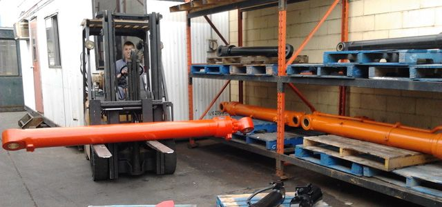 forklift carrying piping